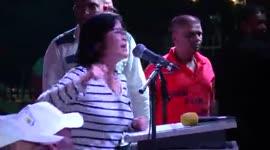 Noreen Cheung en Charles Pahlad prominent aanwezig tijdens massameeting V7...